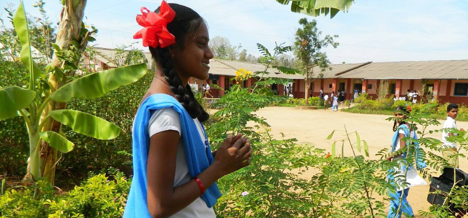 Girl in front of a school